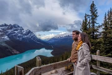 Couple overlooking glacial lake